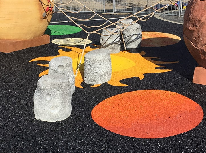 Poured rubber surface with fun designs for a playground.